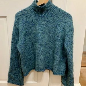 Blue turtle neck sweater with metallic strings